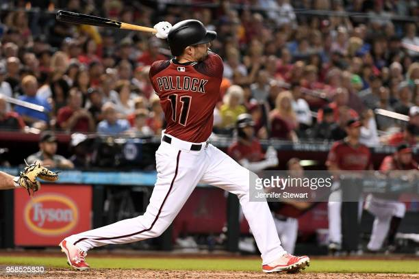 J Pollock of the Arizona Diamondbacks triples in the sixth inning of the MLB game against the Houston Astros at Chase Field on May 6 2018 in Phoenix...