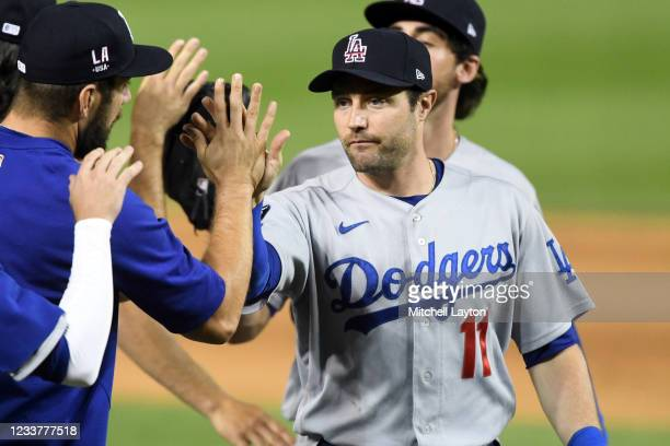 Pollock of the Los Angeles Dodgers celebrates a win after a baseball game against the Washington Nationals at Nationals Park on July 2, 2021 in...