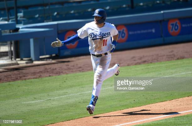 Pollock of the Los Angeles Dodgers celebrates his three run home run against relief pitcher Tyler Rogers of the San Francisco Giants during the...