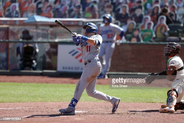 Pollock of the Los Angeles Dodgers hits a two run home run in the seventh inning against the San Francisco Giants at Oracle Park on August 27, 2020...