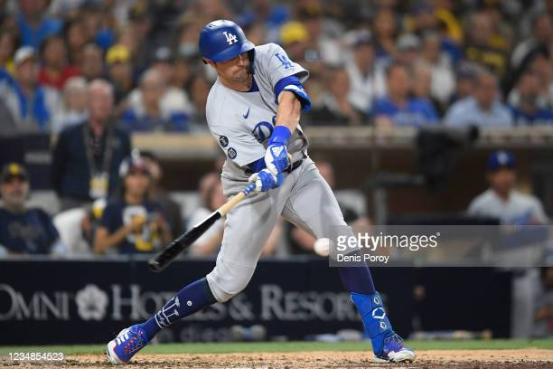 Pollock of the Los Angeles Dodgers hits an RBI single during the seventh inning of a baseball game against the San Diego Padres at Petco Park on...