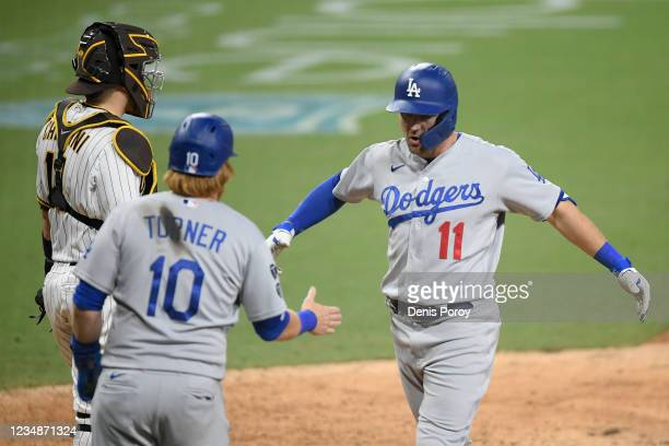Pollock of the Los Angeles Dodgers is congratulated by Justin Turner of the Los Angeles Dodgers after hitting two-run home during the 16th inning of...