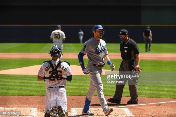 Pollock of the Los Angeles Dodgers reacts in front of Jacob Nottingham of the Milwaukee Brewers after hitting a grand slam in the first inning at...
