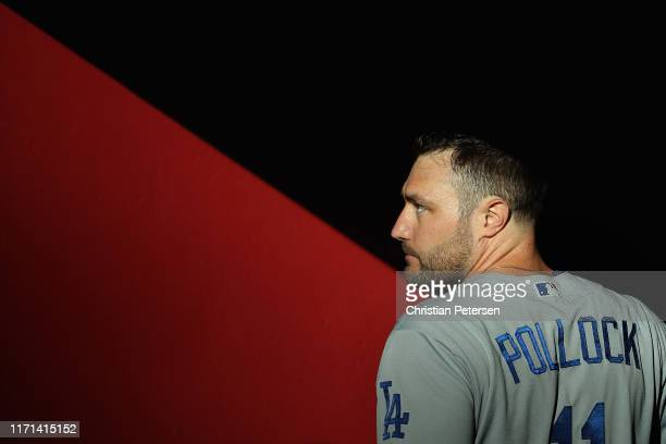 Pollock of the Los Angeles Dodgers stands in the dugout before the start of the MLB game against the Arizona Diamondbacks at Chase Field on August...