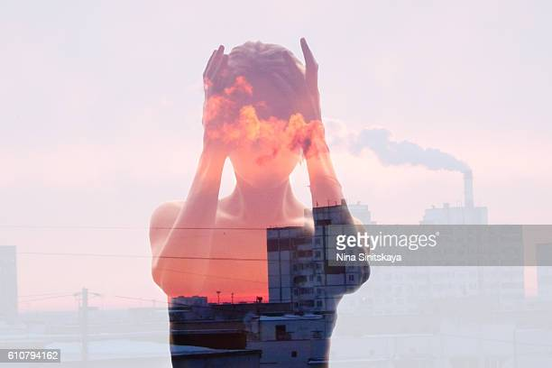 Polluted city and woman's body - double exposure image