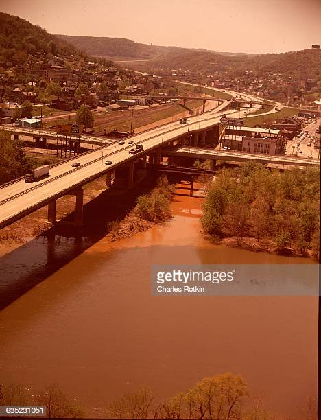 Polluted stream caused by excess sulfuric acid in mine waste running over iron pyrites in water causes stream to turn red This stream empties into...
