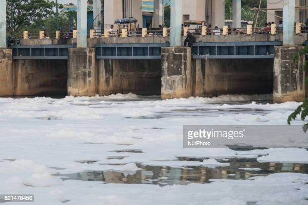 Polluted toxic white foam flow along Jakarta East Flood Canal to Jakarta Bay Indonesia on July 23 2017 This water pollution expected comes from home...