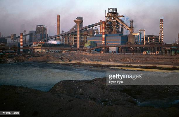 Polluted waste water in the Bao Steel mill Baotou, Inner Mongolia, China. Baotou is an excellent example of a one-industry town, and that industry is...