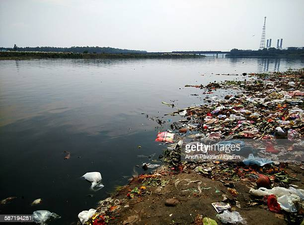 polluted yamuna river against sky - hygiene stock pictures, royalty-free photos & images