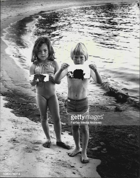 Pollute'Sevenyearold Morgan Duncan and his sister Carole of Watsons Bay show the heavy black bunkering oil washed up on popular Camp Cove beach...
