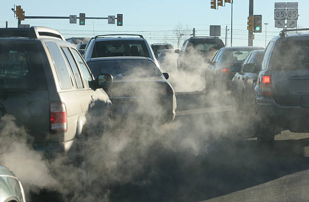 polluting clouds of exhaust fumes rise in the air - car exhaust stock pictures, royalty-free photos & images