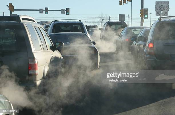 polluting clouds of exhaust fumes rise in the air - global warming stock pictures, royalty-free photos & images