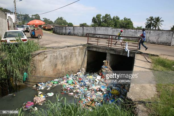 Polluting plastic waste are seen clogging a canal in the Cocotier district in Libreville on May 31 2018 The United Nations celebrate on June 5 the...