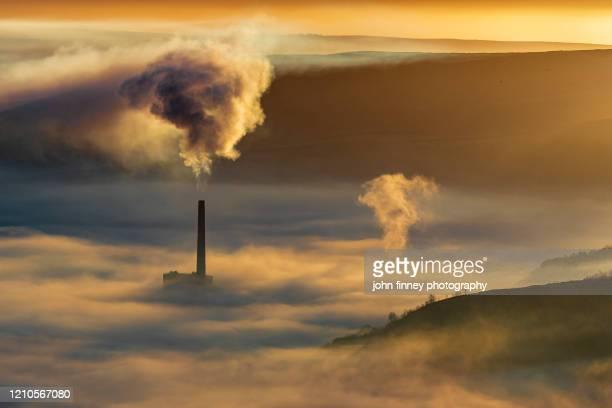pollution at sunrise, castleton, derbyshire, peak district. uk - climate change stock pictures, royalty-free photos & images