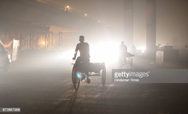 Pollution due to heavy smog seen near a construction site at the Akshardham Road on November 11 2017 in New Delhi India Experts have compared...