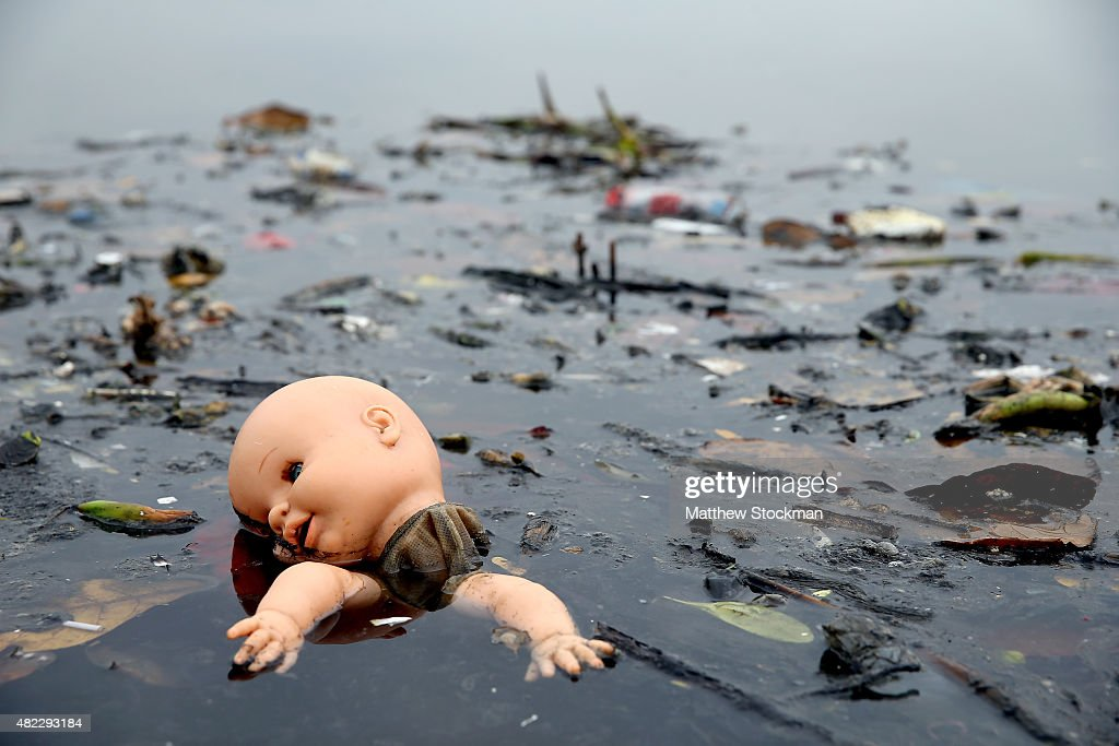 Pollution floats in Guanabara Bay, site of sailing events for the Rio 2016 Olympic Games, on July 29, 2015 in Rio de Janeiro, Brazil. The Rio government promised to clean 80 percent of pollution and waste from the bay in time for the games but admits that goal now is unlikely to be reached. August 5 marks the one-year mark to the start of the Rio 2016 Olympic Games.