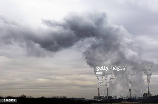 pollution spilling into the sky from a power plant - carbon dioxide stock pictures, royalty-free photos & images