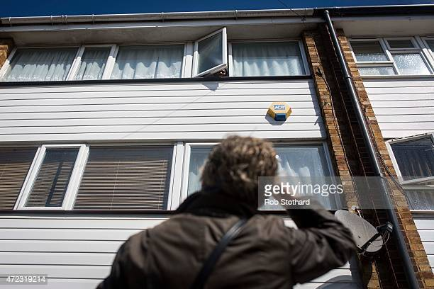 Polly Billington Labour Party candidate for Thurrock speaks to a woman through the window of her flat as she campaigns in Tilbury on May 6 2015 in...