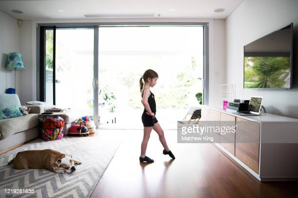 Polly King daughter of photographer Matt King is seen watching a ballet class in her home on March 28 2020 in Sydney Australia Around the globe...