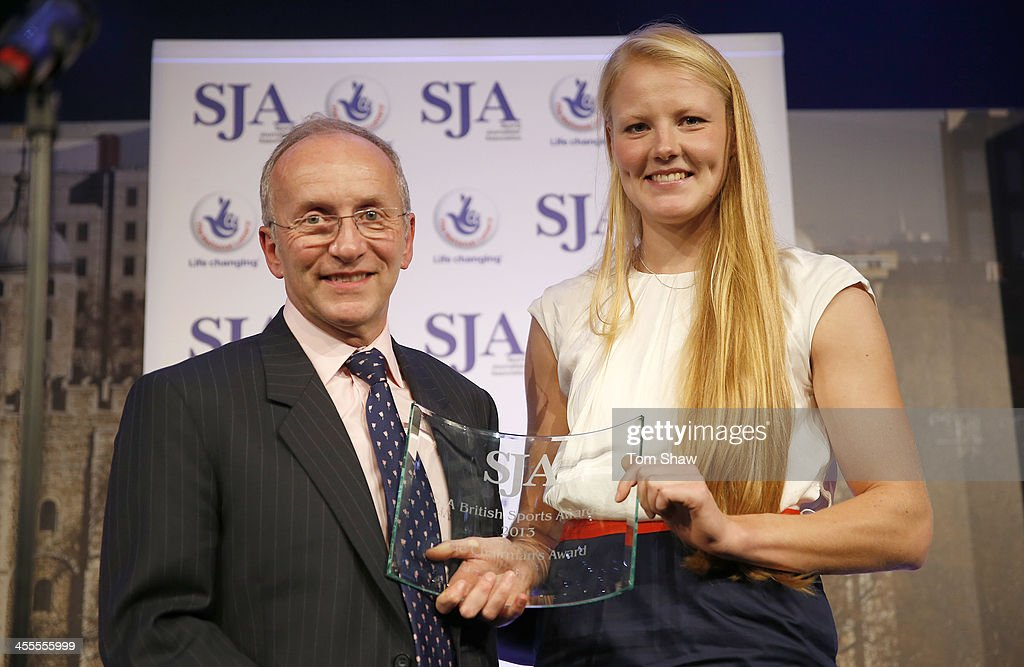 Polly Swann receives the SJA Chairmans award from the SJA Chairman David Walker during the SJA British Sports Awards at Tower of London on December 12, 2013 in London, England.
