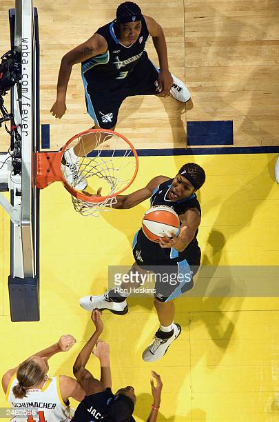 Pollyanna Johns Kimbrough of the Cleveland Rockers goes to the basket against the Indiana Fever during the game at Conseco Fieldhouse on August 23...