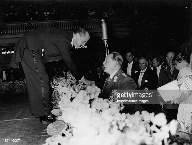 Polnish tenor Jan Kiepura talks with Hermann Göring Opening of the GermanPolnishInstitut in the Marmorsaal/Zoo Berlin 1935 Photograph Der polnische...