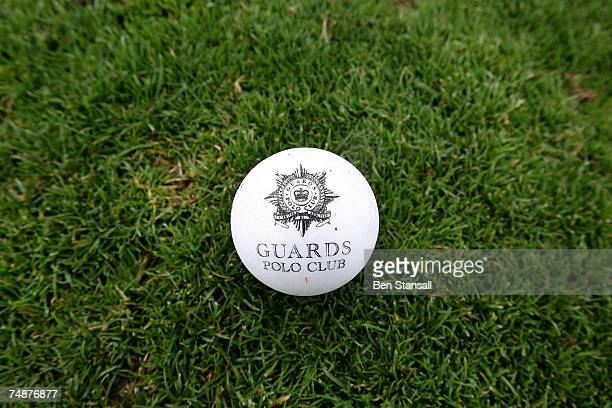 A polo ball with the words 'Guards Polo Club' displayed on it is sits on the turf before The Credit Suisse Royal Windsor Cup Final at Guards Polo...