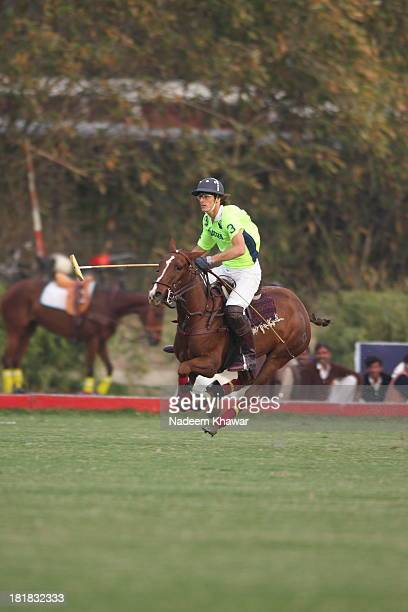 Polo player at Polo ground enjoying the ride after making a goal. Polo Tournaments held every year at Lahore and teams from all Pakistan take part...