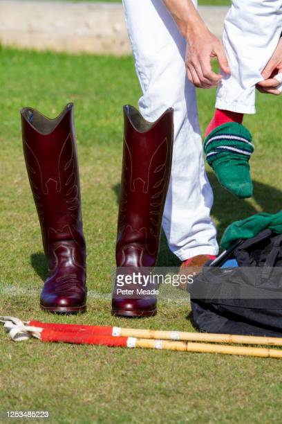 polo player getting dressed for a game - polo stock pictures, royalty-free photos & images