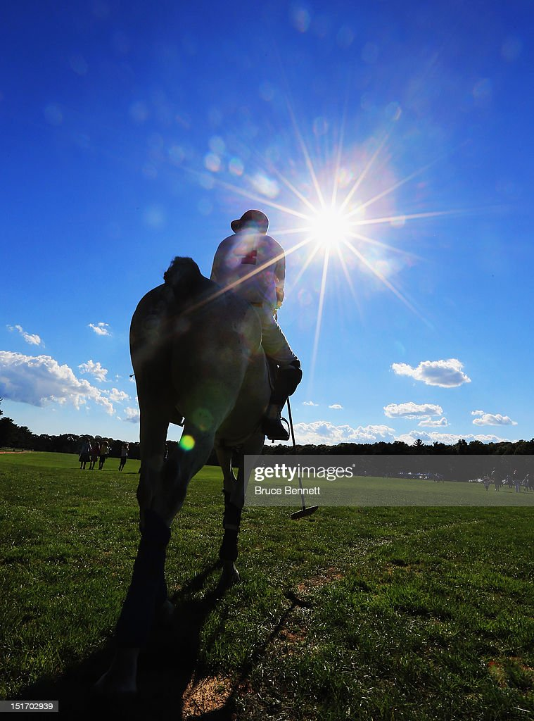 A polo player heads out for a game between Team Mercedes and the Caballeros Polo Team in Bethpage State Park on September 9, 2012 in Bethpage, New York.