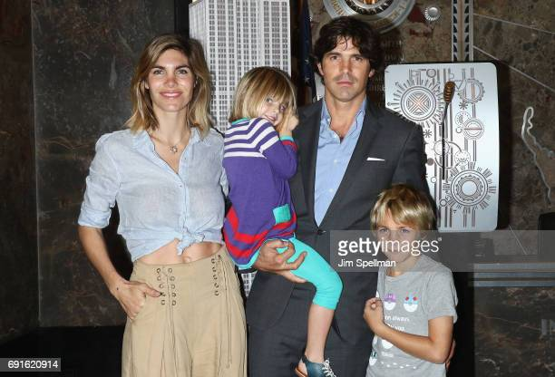 Polo player Nacho Figueras with wife Delfina Blaquier and children light the Empire State Building in celebration of 10th anniversary of Veuve...