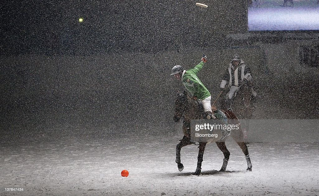 A polo player swings his mallet during play at the annual Klosters Snow Polo event in Klosters, Switzerland, on Friday, Jan. 20, 2012. German Chancellor Angela Merkel will open next week's World Economic Forum in Davos, Switzerland, which will be attended by policy makers and business leaders including U.S. Treasury Secretary Timothy F. Geithner. Photographer: Scott Eells/Bloomberg via Getty Images