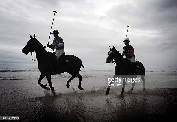 Polo players Andy Burgess on Shriva and Rob Brockett on his horse Pachu practise on the beach ahead of tomorrow's beach polo event on September 10...