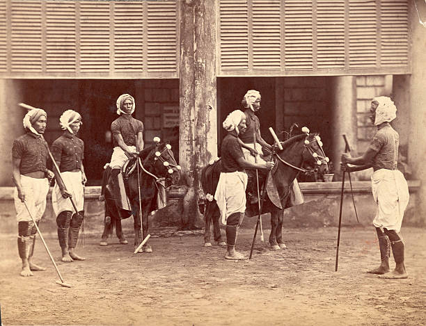 Polo players from Manipur in India prepare for a match,...
