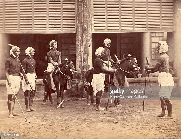 Polo players from Manipur in India prepare for a match circa 1885