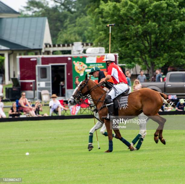 polo players in a match competing for the ball - ogphoto stock pictures, royalty-free photos & images