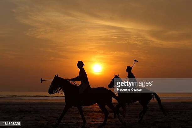 CONTENT] Polo players playing match at the beach of Karachi Sindh Pakistan