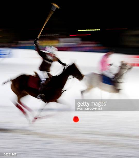 MINA polo players prepares to hit with his mallet during a night game on January 22 2011 in KlostersThe little village of Klosters in the Swiss alps...