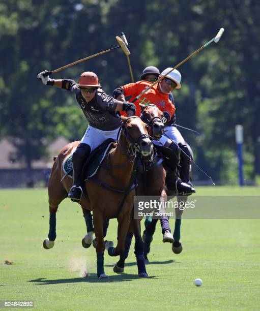 Polo players take part in a match in Bethpage State Park on July 30 2017 in Bethpage New York