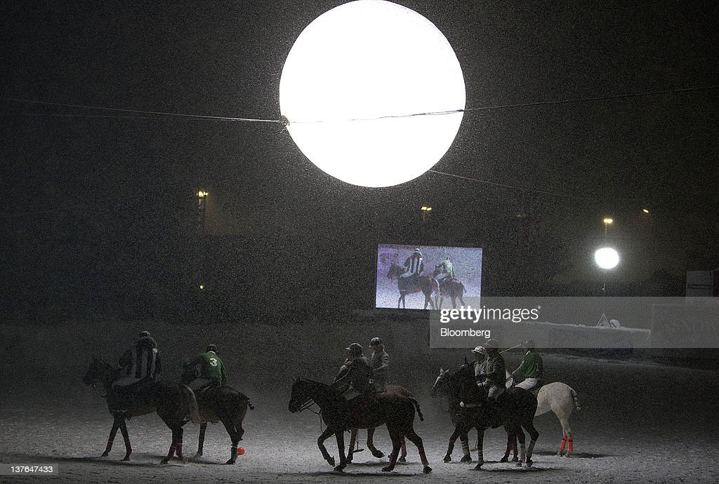Polo players take to the field at the annual Klosters Snow Polo event in Klosters, Switzerland, on Friday, Jan. 20, 2012. German Chancellor Angela Merkel will open next week's World Economic Forum in Davos, Switzerland, which will be attended by policy makers and business leaders including U.S. Treasury Secretary Timothy F. Geithner. Photographer: Scott Eells/Bloomberg via Getty Images