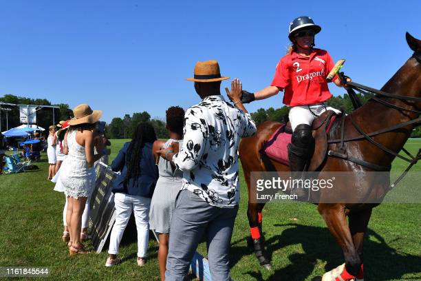 Polo players visit guests after a polo match produced by Grandiosity Events CigarsGuitars Charity PoloJazz charity event Powered by Logical...