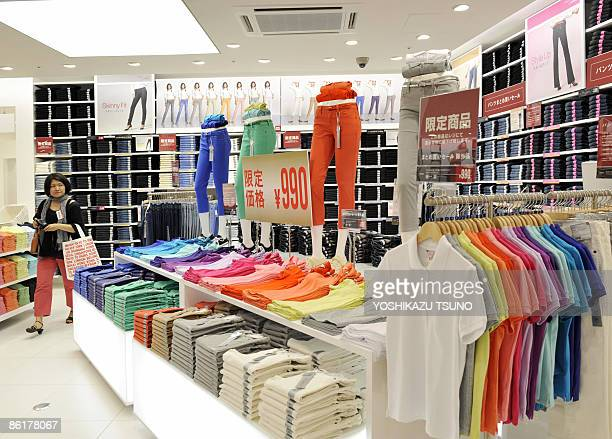 Polo shirts jeans and casual wears of Japan's largest casual brand Uniqlo are displayed at the press preview of the company's mega shop at Tokyo's...