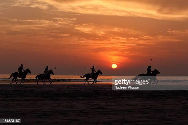 Polo team playing match at the Clifton beach. Karachi.