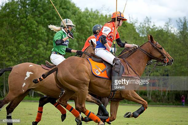 Polo teams challenging for the ball