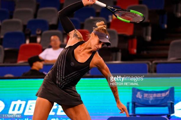 TOPSHOT Polona Hercog of Slovenia breaks her racket while playing against Petra Kvitova of Czech Republic during their Second round women's singles...
