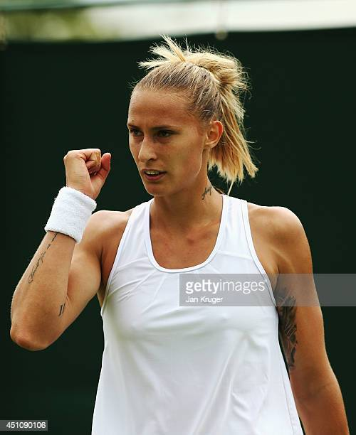 Polona Hercog of Slovenia celebrates a point during her Ladies' Singles first round match against Paula Ormaechea of Argentina on day one of the...