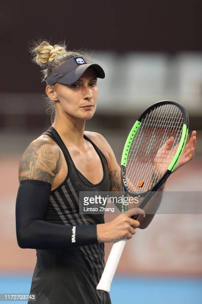 Polona Hercog of Slovenia celebrates after defeating against Angelique Kerber of Germany during the Women's Singles 2nd Round of 2019 China Open at...