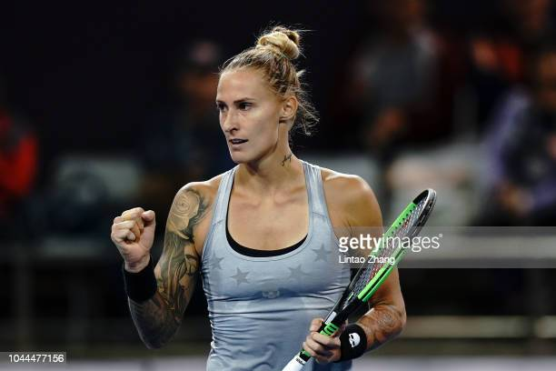 Polona Hercog of Slovenia celebrates after winning a point against Caroline Garcia of France during their Woen's Singles 2nd Round match of the 2018...