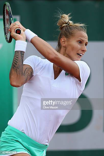 Polona Hercog of Slovenia follows through during her Women's Singles match against Shuai Peng of China on day one of the 2015 French Open at Roland...