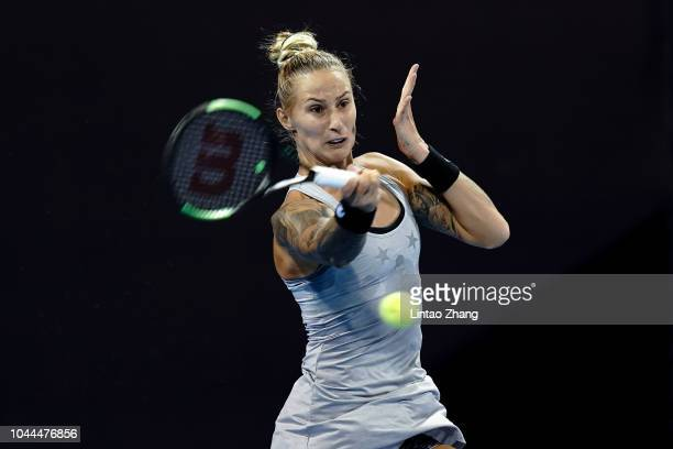 Polona Hercog of Slovenia hits a return against Caroline Garcia of France during their Woen's Singles 2nd Round match of the 2018 China Open at the...